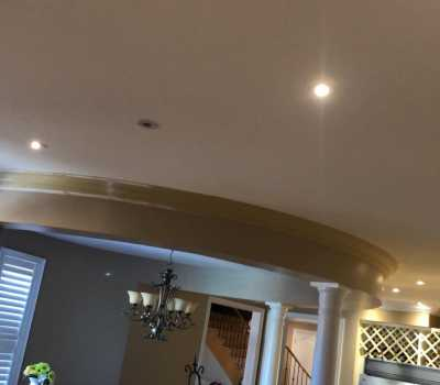 Flexible crown molding installation in living room