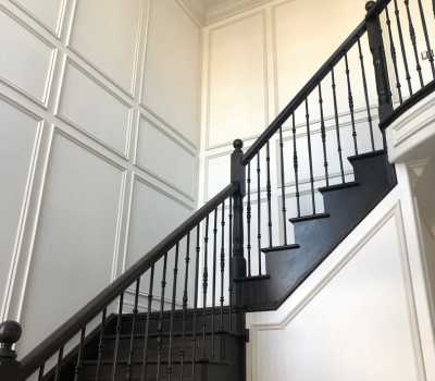 staircase with wainscotting wall decor