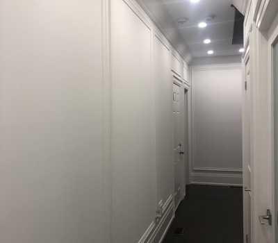 hallway with wainscotting trim