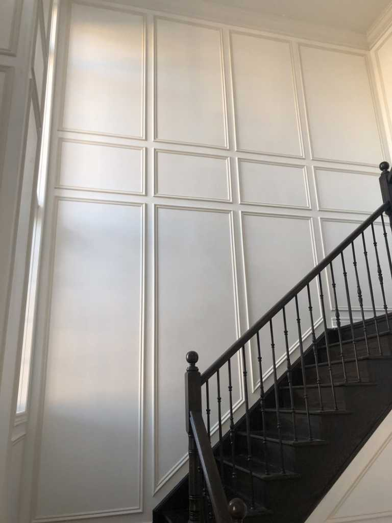 staircase with Decorative Trim wall