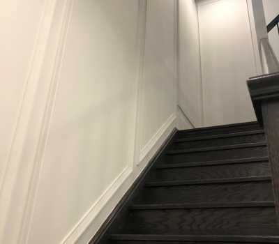staircase with luxury wall wainscoting decor