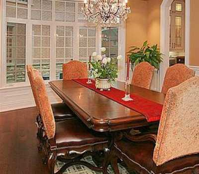 luxury dining room with crown moulding and wainscoting wall decor
