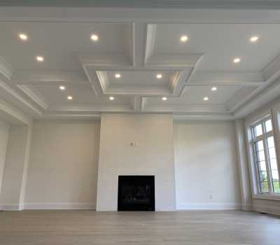classic living room with custom fire place and waffle ceiling trim toronto