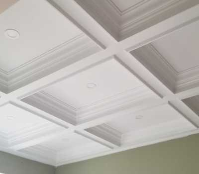 custom home with waffle ceiling trim
