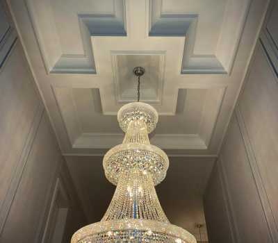 luxury hallway with waffle ceiling and custom shandalar