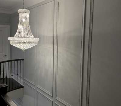 wooden staircase with metal railings and gray cofferd wall trim GTA
