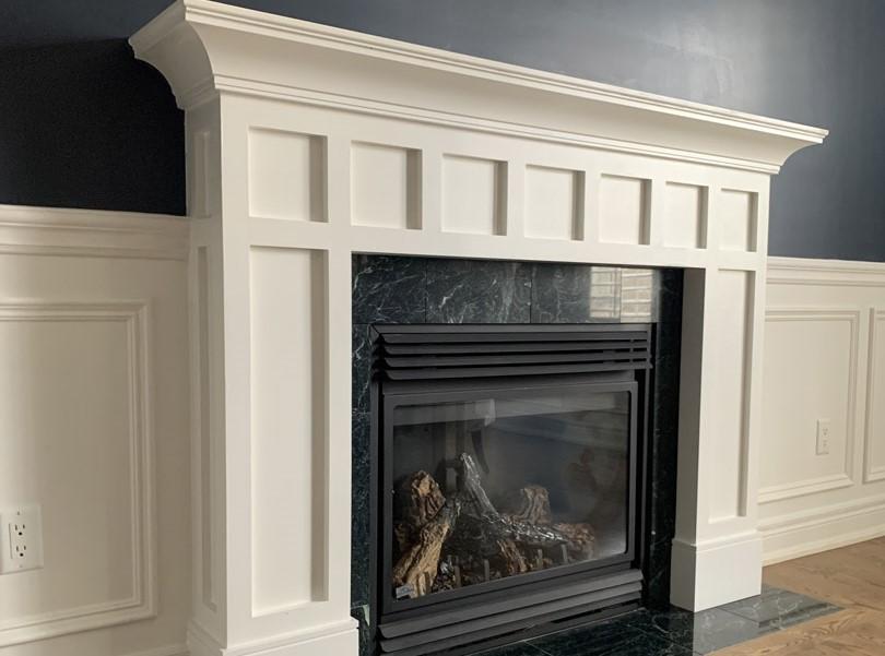 amazing Fireplace Mantel in custom living room - trim carpenter toronto