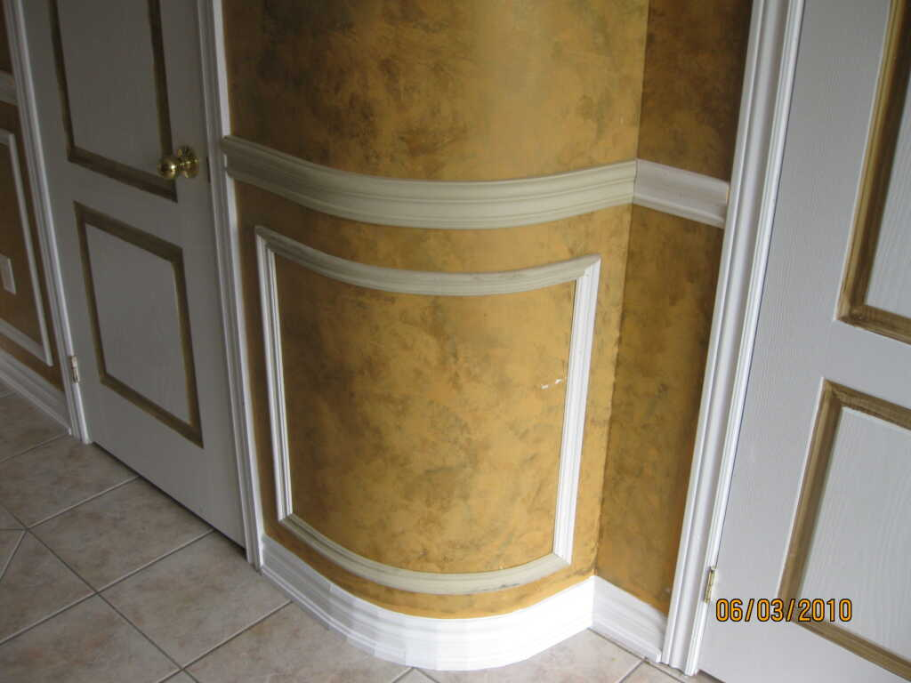 Luxury White and Gold Wainscoting Installation in The Hallway Milton